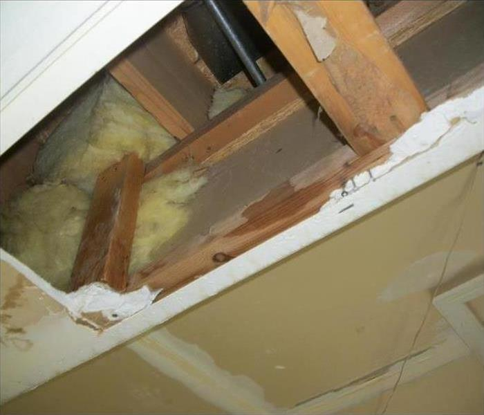 Ceiling tile removed due to water damage
